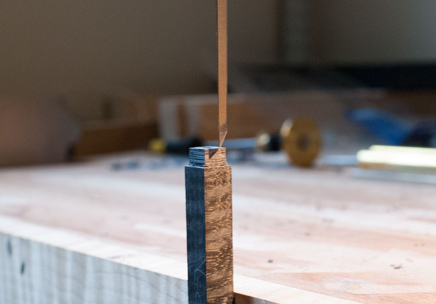 Paring down the tenon with a chisel to round it to the shape of the ferrule.